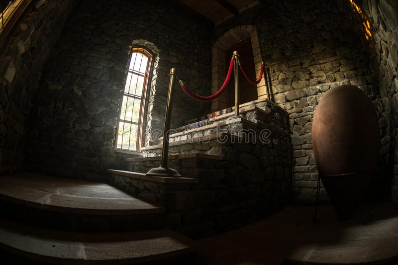 Inside of old creepy abandoned mansion. Staircase and colonnade. Dark castle stairs to the basement. Spooky dungeon stone stairs. In old castle. Horror royalty free stock photo