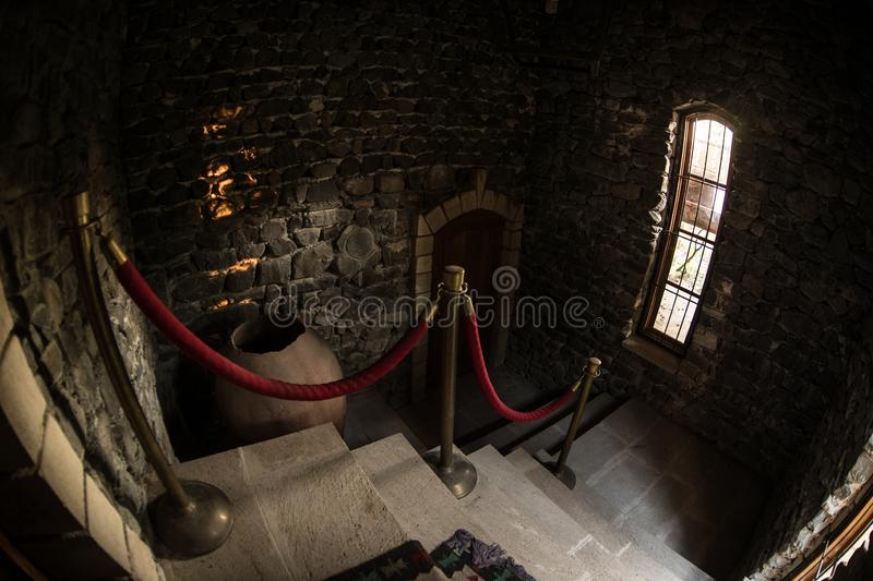 Inside of old creepy abandoned mansion. Staircase and colonnade. Dark castle stairs to the basement. Spooky dungeon stone stairs. In old castle. Horror stock photos
