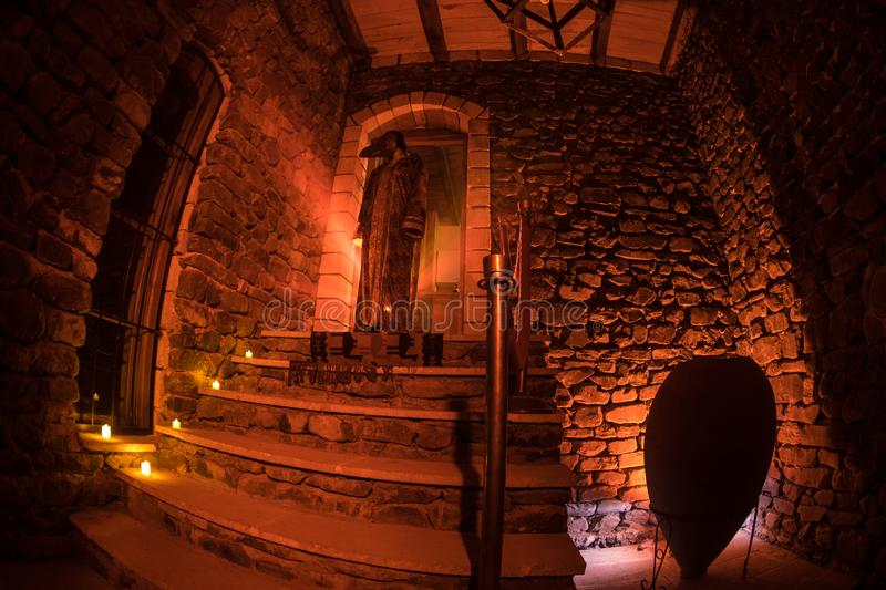 Inside of old creepy abandoned mansion. Staircase and colonnade. Silhouette of horror ghost standing on castle stairs to the basem stock photography