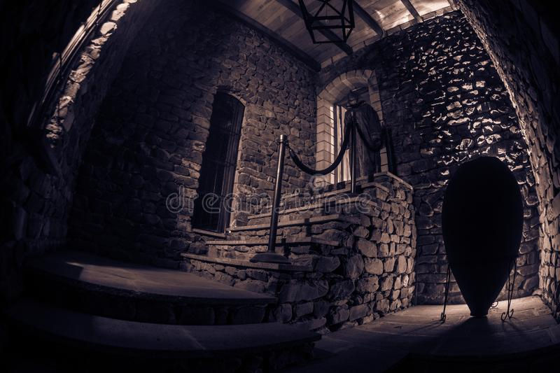 Inside of old creepy abandoned mansion. Staircase and colonnade. Silhouette of horror ghost standing on castle stairs to the. Inside of old creepy abandoned stock images
