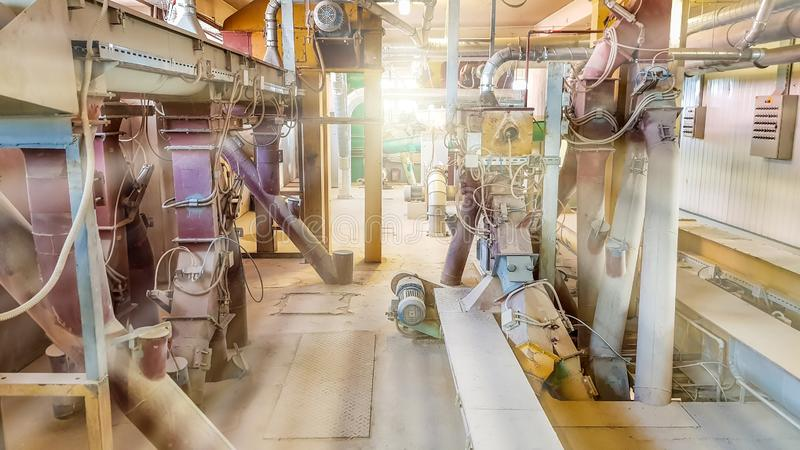 Inside old industrial factory with lots of metal cables and pipes royalty free stock photo
