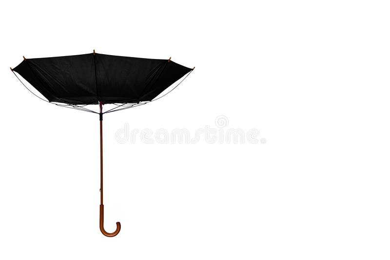 Inside Out Black Umbrella Off Center on White Background. Inside Out Black Umbrella with Wooden Curved Handle Off Center on White Background stock image