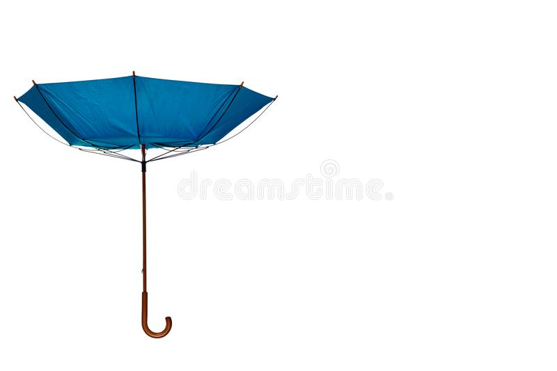 Inside Out Blue Umbrella Off Center on White Background. Inside Out Blue Umbrella with Wooden Curved Handle Off Center on White Background stock photography