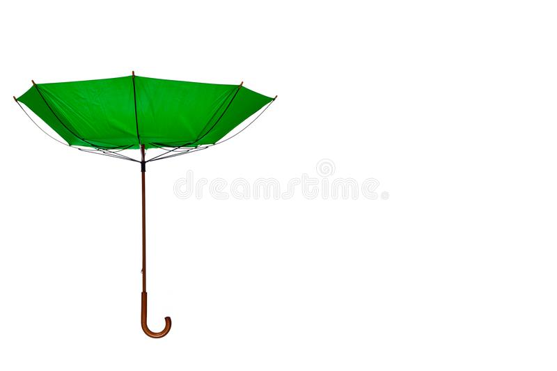 Inside Out Green Umbrella Off Center on White Background. Inside Out Green Umbrella with Wooden Curved Handle Off Center on White Background stock images