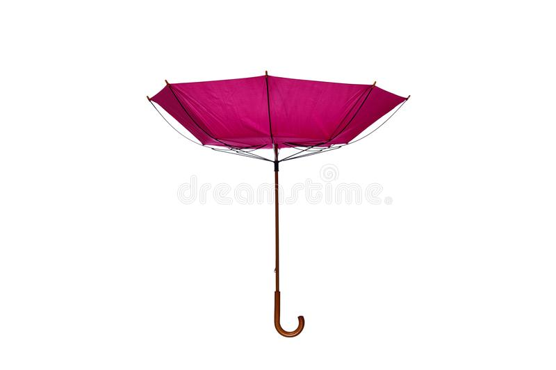Inside Out Pink Umbrella Center on White Background. Inside Out Pink Umbrella with Wooden Curved Handle Center on White Background royalty free stock photo