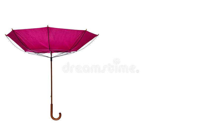 Inside Out Pink Umbrella Off Center on White Background. Inside Out Pink Umbrella with Wooden Curved Handle Off Center on White Background stock image