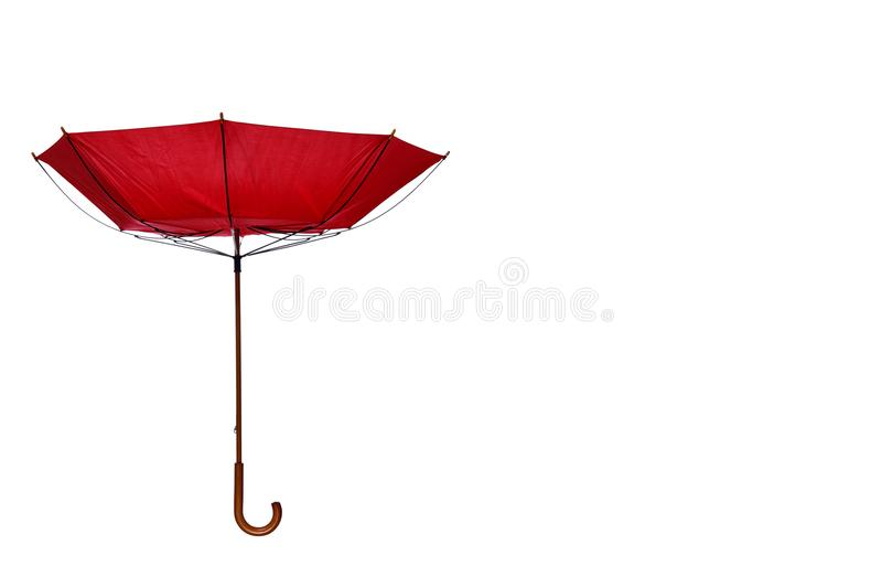 Inside Out Red Umbrella Off Center on White Background. Inside Out Red Umbrella with Wooden Curved Handle Off Center on White Background royalty free stock photos