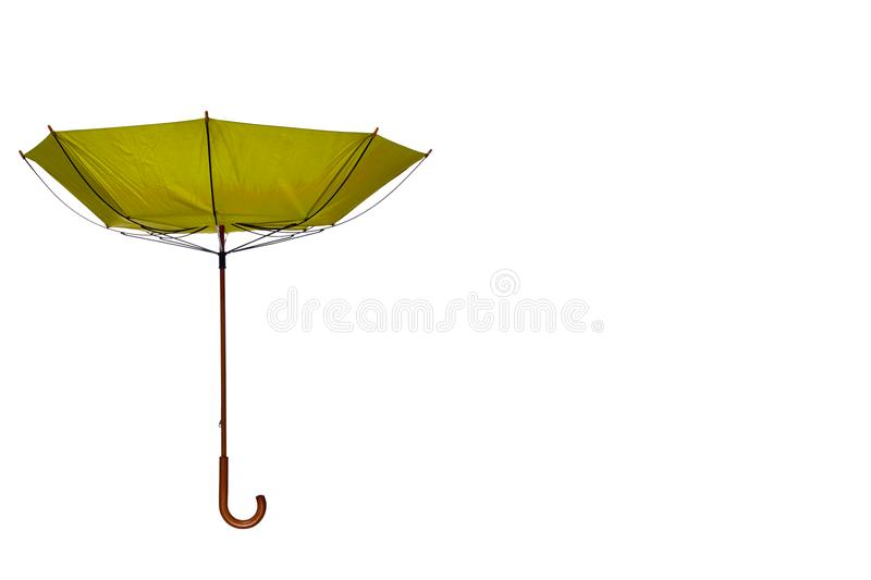 Inside Out Yellow Umbrella Off Center on White Background. Inside Out Yellow Umbrella with Wooden Curved Handle Off Center on White Background royalty free stock images