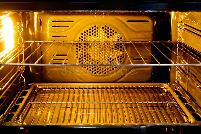 Inside the oven with light royalty free stock images