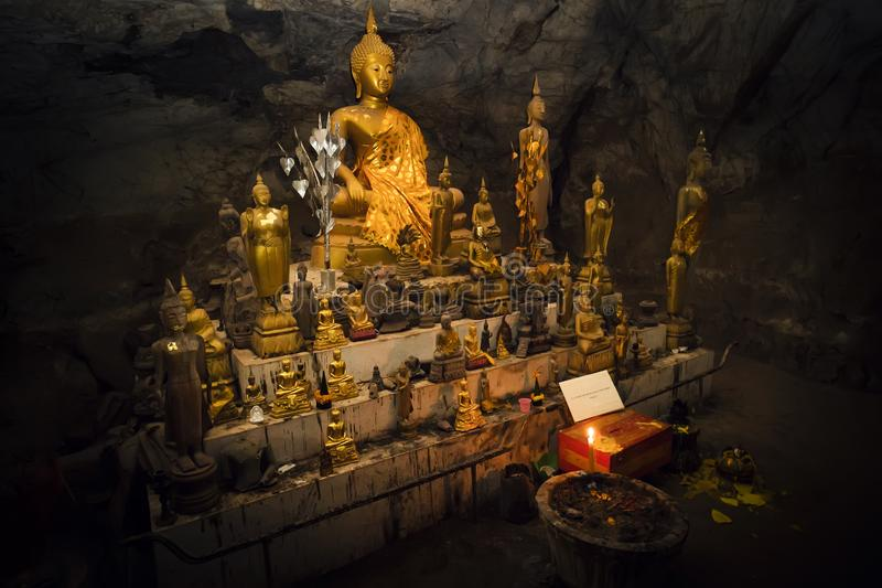 Inside Pak U cave are many gold-plated buddha-figures. cave is situated near Luang Prabang, Laos royalty free stock photos