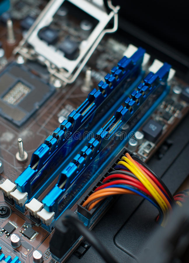 Inside of pc. Motherboard, CPU socket and RAM memory royalty free stock image