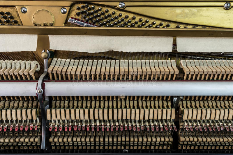 Inside a piano. Wooden parts, mechanisms closeup stock images