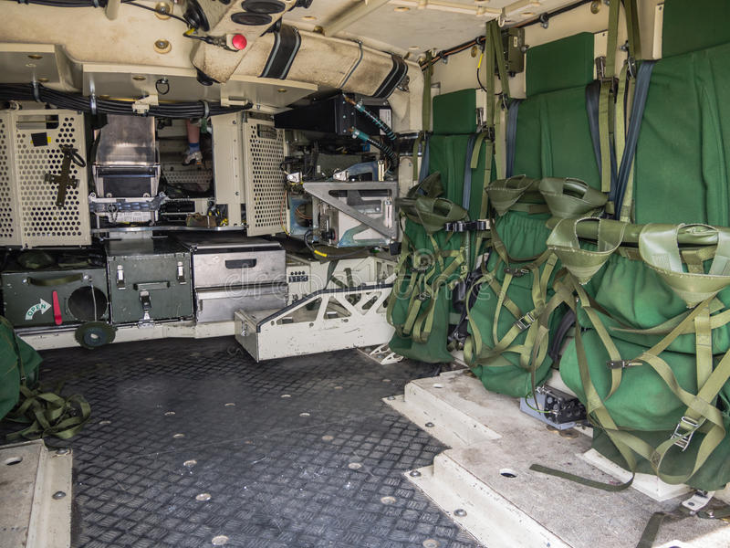 Inside the rear of a Dutch military vehicle. ALMERE, NETHERLANDS - 12 APRIL 2014: Look inside the rear of a military vehicle on display during the first National stock photos