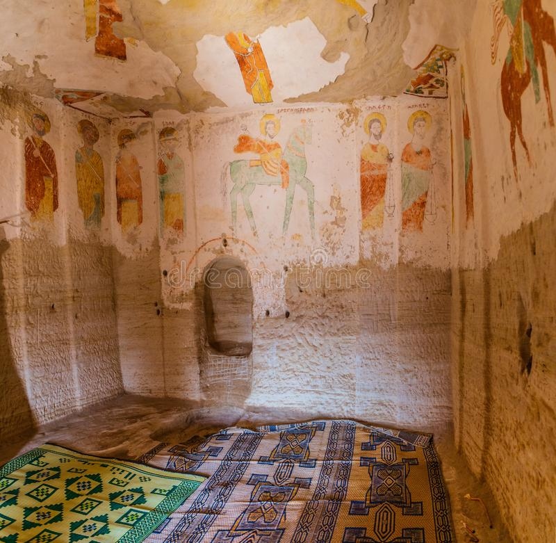 Iconographic wall murals of saints in Daniel Korkor church. Inside the Rock-hewn Churche Daniel Korkor in the region of Tigray stock photo