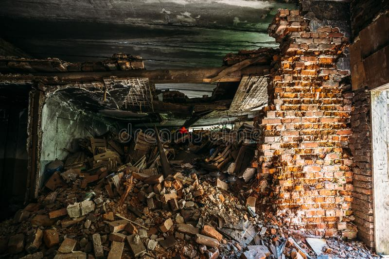Inside ruined abandoned house building after disaster, war, earthquake or other natural cataclysm stock photos