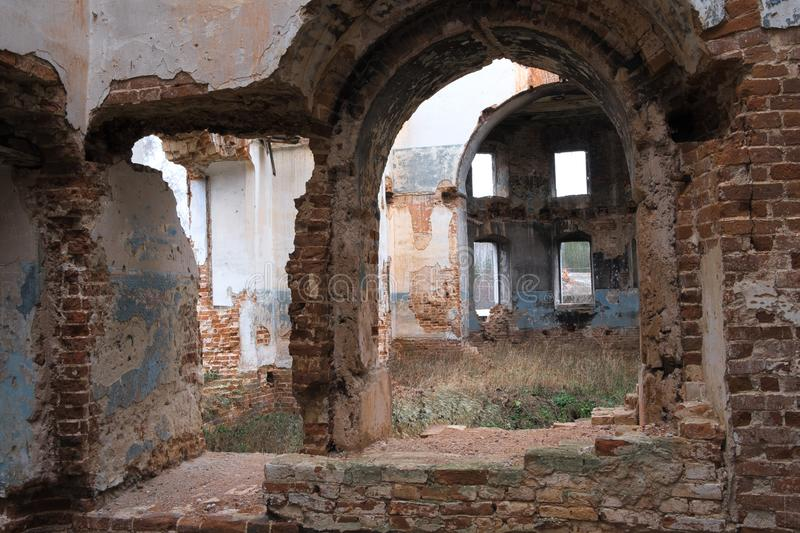 Inside the ruined Church in Russia, old brick walls, shabby ceilings, fallen paint Windows royalty free stock image