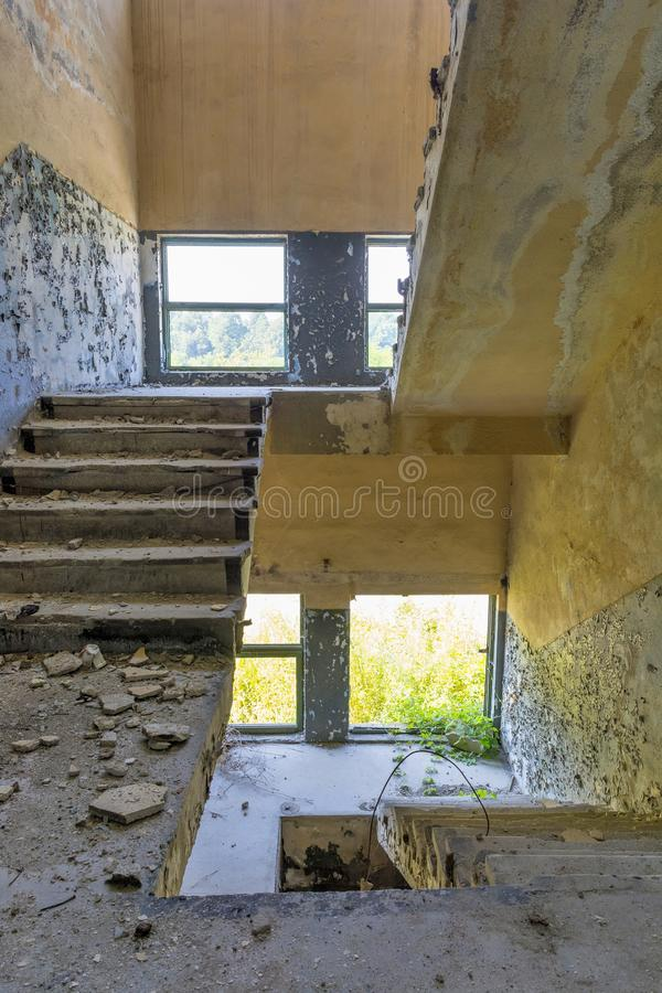 Stair from the old factory. Inside the ruins of an old factory in Romania of a Communist Era. Step inside of abandoned old factory in eastern Europe.Abandoned royalty free stock photo
