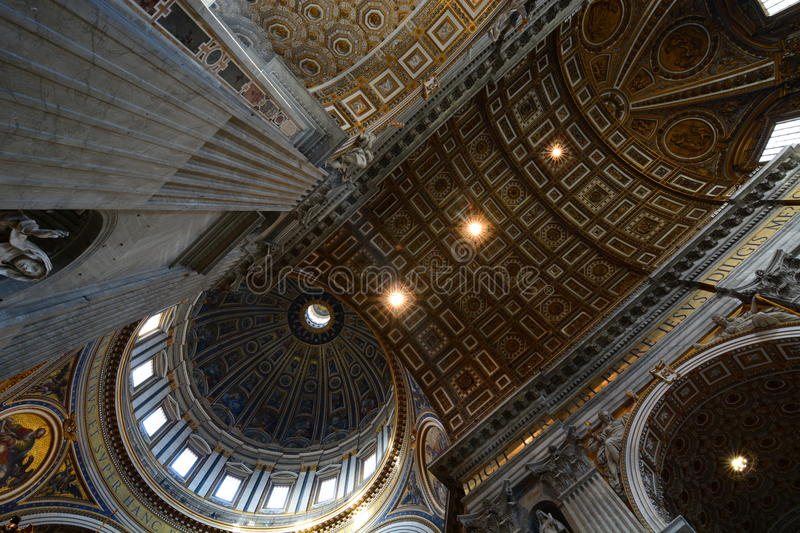 Inside the Saint Peters basilica. Vatican City. St. Peters Basilica (Basilica di San Pietro in Vaticano) is a Late Renaissance church located within Vatican City stock images