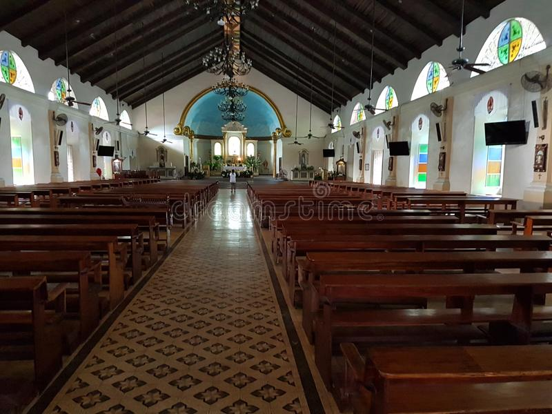 Inside San Juan church in Batangas city, Philippines. NBuilt in the 1800`s was completely destroyed by a flood shortly after then rebuilt using rocks stock photo