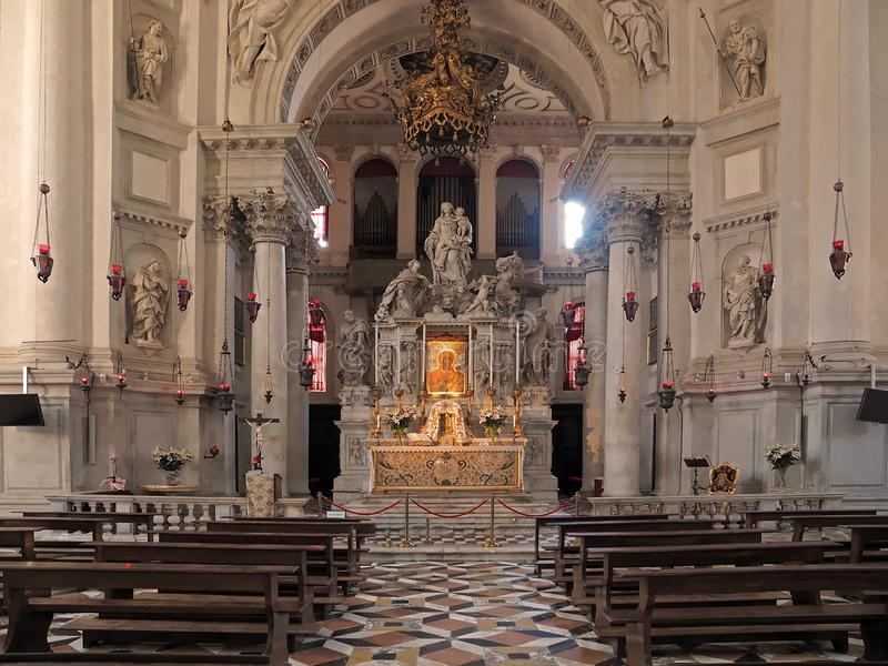 Inside Santa Maria della Salute, cathedral of Venice with sculptures and details royalty free stock images
