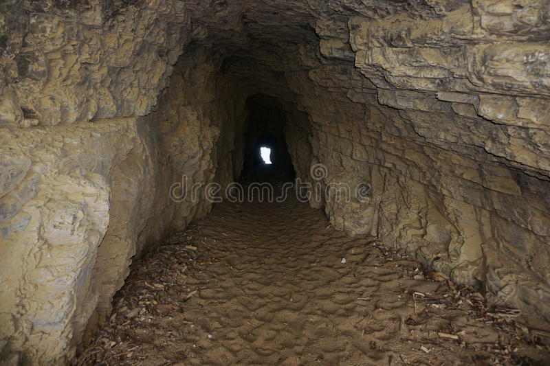 Inside a small tunnel in the rock royalty free stock images