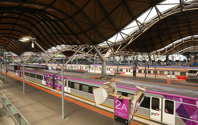 Trains inside the Southern Cross station in Melbourne, Australia royalty free stock images