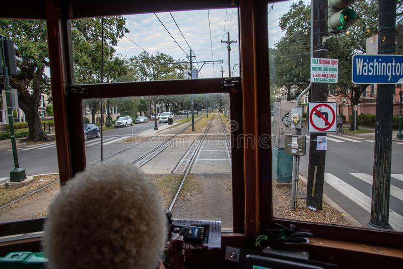 From inside the St. Charles streetcar in NOLA. St. Charles streetcar in New Orleans is the oldest working one in the world stock photo