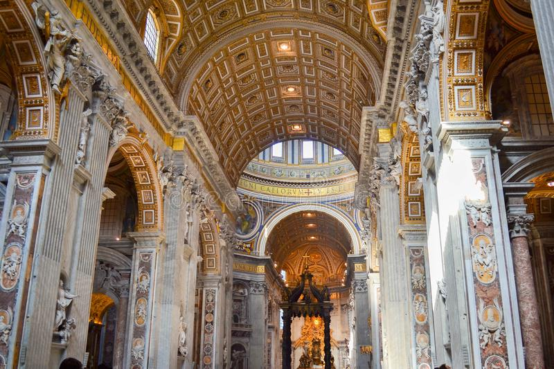 Inside of St. Peter`s Basilica in Vatican City, Italy, with St. Peter`s Baldachin Baldacchino di San Pietro, L`Altare di Bernini in the background royalty free stock image