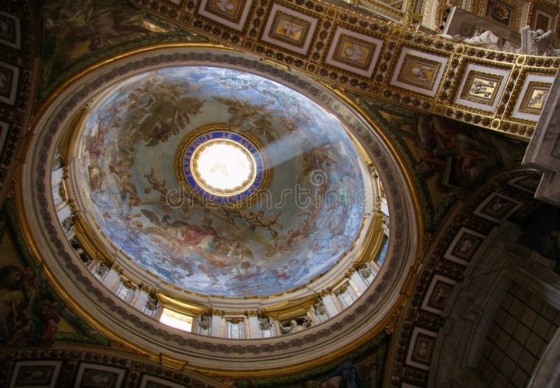 The inside of St. Peter`s and the Vatican. The Papal Basilica of St. Peter in the Vatican Italian: Basilica Papale di San Pietro in Vaticano, or simply St. Peter stock photography