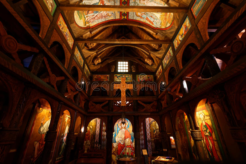 Inside stave church replica. Inside a Norwegian stave church - a medieval wooden church building. Replicated and on display in Europa Park Rust, Germany stock images