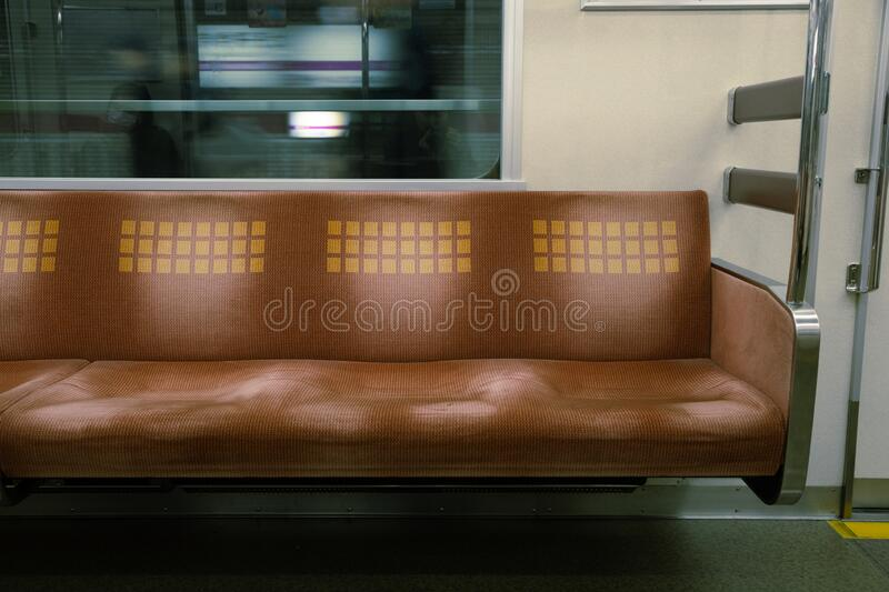 Inside of subway with empty seats in Osaka, Japan. Asia royalty free stock photo