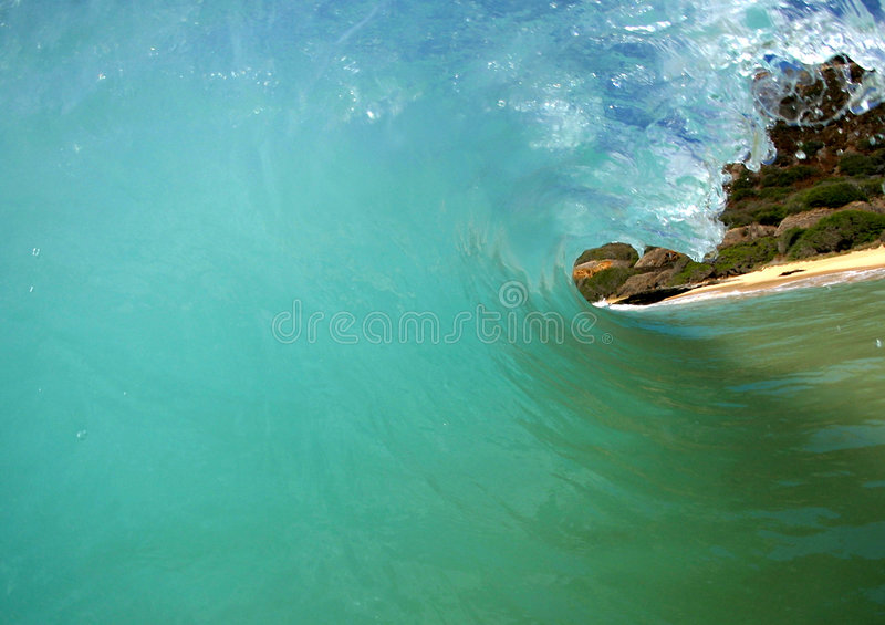 Inside a Tubing Blue Pacific Wave. A breaking wave at Sandy Beach on the island of Oahu, Hawaii royalty free stock images