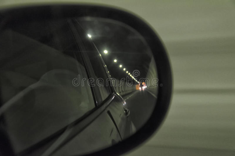Inside a tunnel in a highway. Mirror view inside a tunnel in a highway stock images