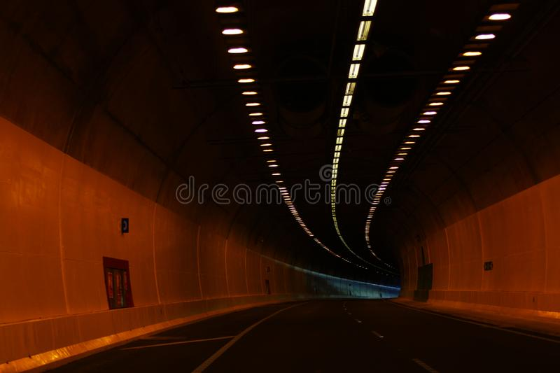 Inside of tunnel with lights stock image