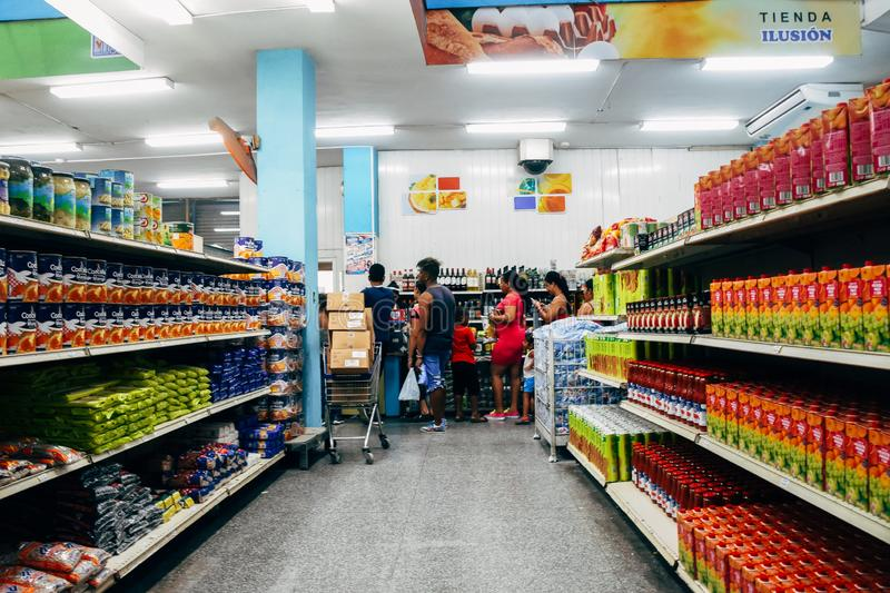 Inside a typical grocery store in Havana city, Cuba. A long line up inside a typical grocery store in Havana city, Cuba royalty free stock image