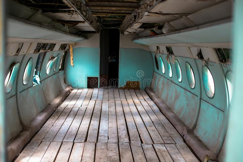 Inside a very old plane. Passenger cabin of a small old plane. royalty free stock photography