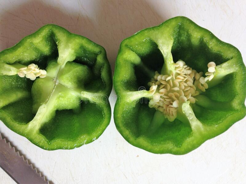 Inside view of bisected capsicum halves royalty free stock photography