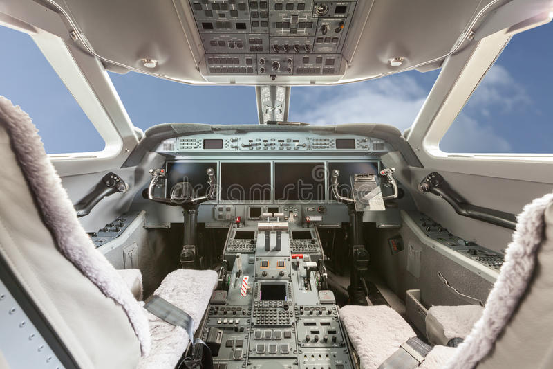Inside view Cockpit G550 with blue sky and clouds royalty free stock photos