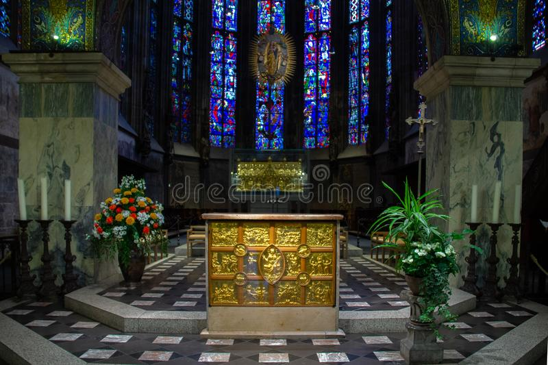Altar in church and in the background stained glass windows. Inside view of dome Aachener Dom. Roman Catholic church in Aachen, western Germany, It is claimed as royalty free stock photos