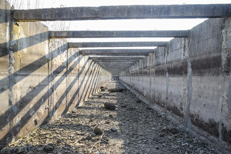 inside view of the irrigation artificial concrete channel stock photos
