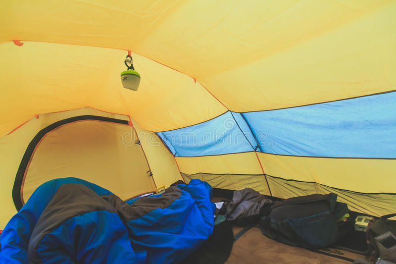 An inside view of tent, process of camping in fall or spring forest field, setting a tent covered royalty free stock image