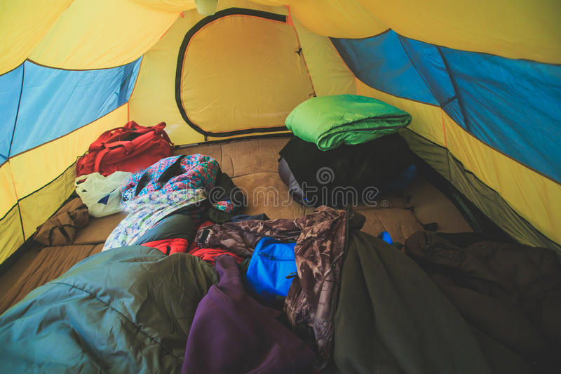 An inside view of tent, process of camping in fall or spring forest field, setting a tent covered royalty free stock photos