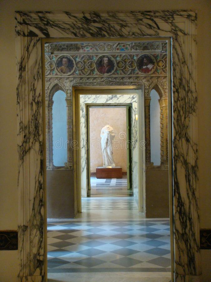 Inside of the Villa Torlonia with a corridor of marble with after all an antique statue, Rome, Italy. stock image