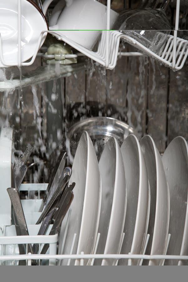 Inside working dishwasher royalty free stock photo