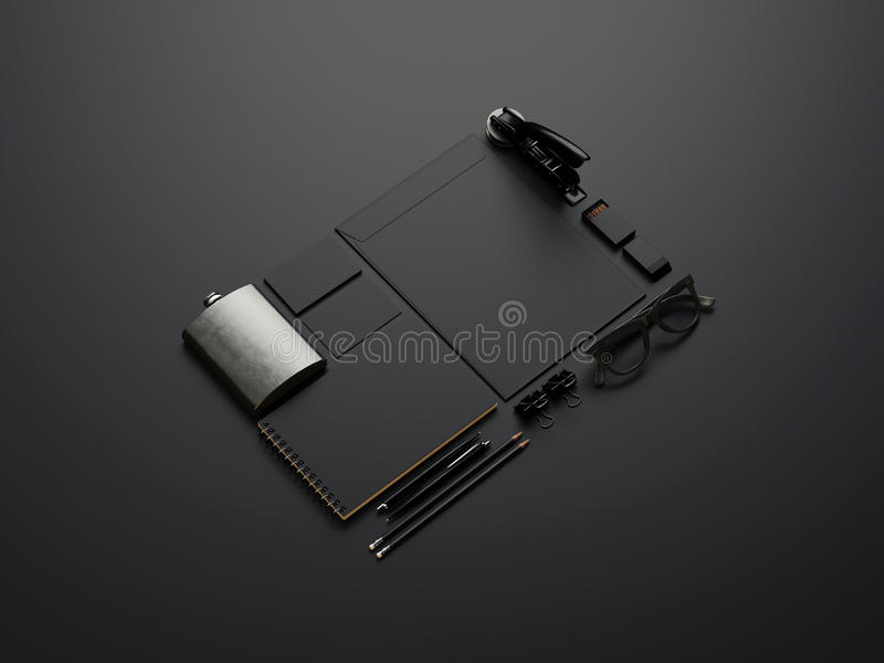 Insieme degli elementi marcanti a caldo neri su carta nera fotografia stock
