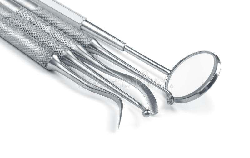 Insieme degli strumenti dell'attrezzatura medica dal metallo per cure odontoiatriche dei denti fotografie stock