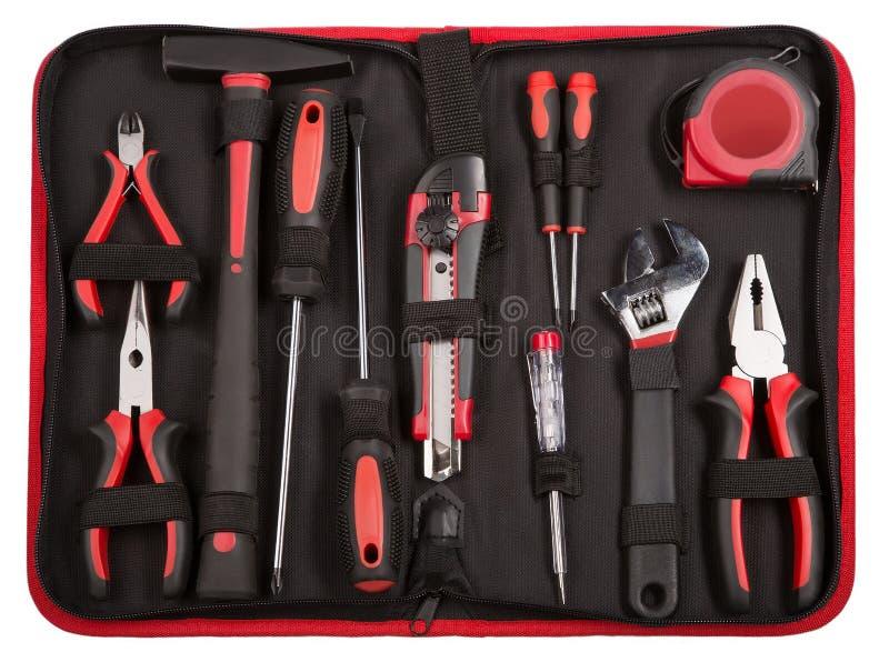 Insieme degli strumenti e degli strumenti sul fondo nero del tessuto. immagini stock libere da diritti