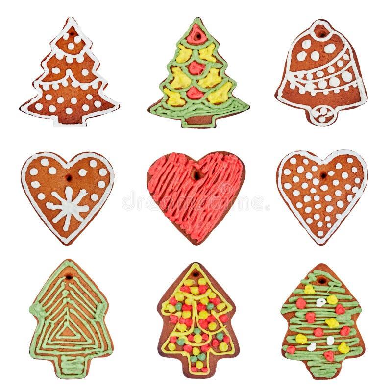 Insieme dei biscotti casalinghi del pan di zenzero isolati sopra bianco Cuore, albero di Natale, campana fotografia stock