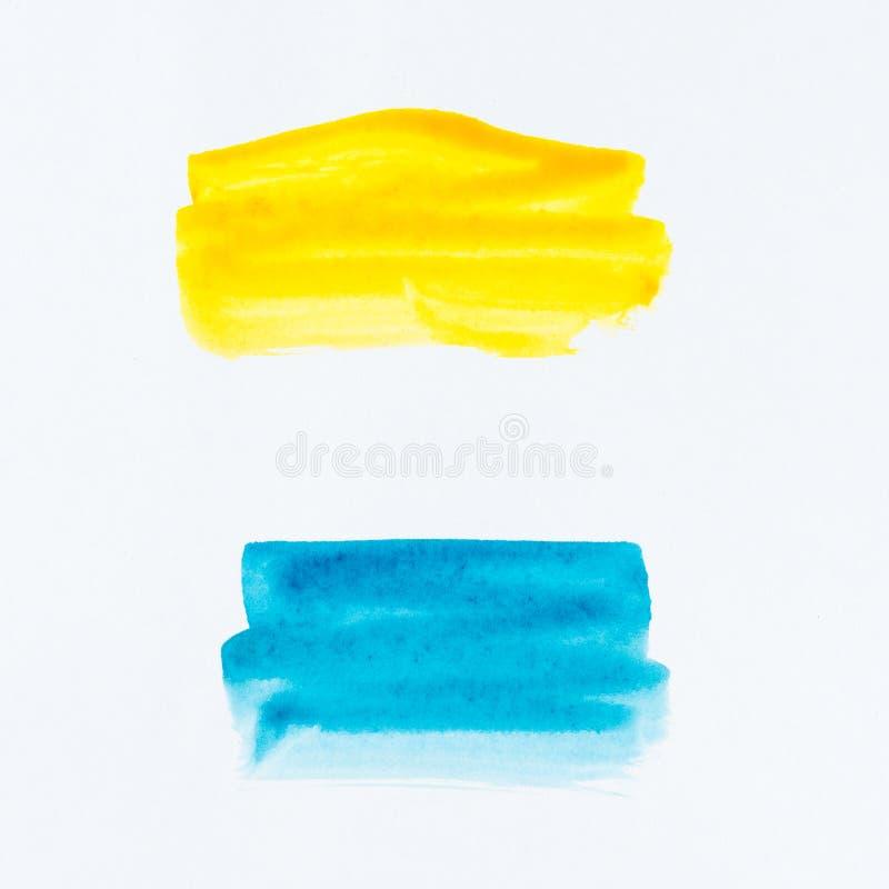 Insieme dei colpi della spazzola dell'acquerello di pittura blu e gialla su briciolo immagini stock libere da diritti
