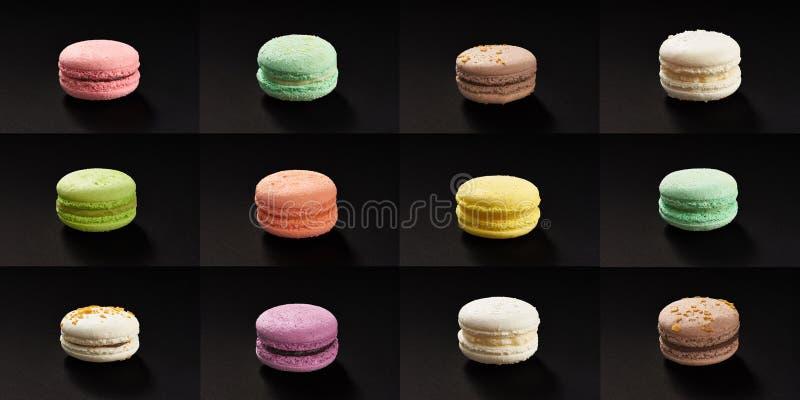 Insieme dei molti maccheroni multicolori Maccheroni deliziosi isolati su fondo nero Biscotto dolce francese fotografia stock libera da diritti
